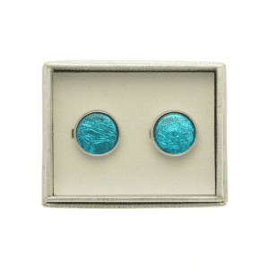 A stylish pair of cufflinks using a bright turquoise resin with an aluminium foil backing creating shine. The cufflinks have a diameter of 1.7cm.